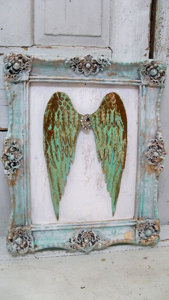 Framed metal wings turquoise green rust and gold surrounded by tones of blue gold and white anita spero