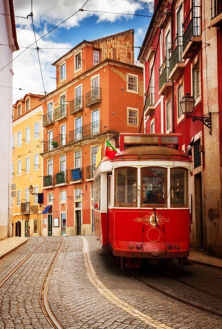 tram on narrow street of Alfama, Lisbon, Portugal, retro toned Copyright  Neirfy