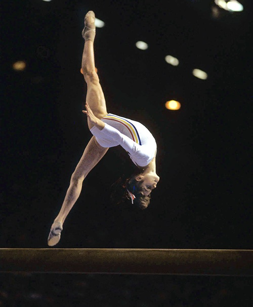 Nadia Comaneci  Montreal Summer Olympics  |  Aug. 2, 1976  |  Photo By Neil Leifer/SI  Nadia Comaneci of Romania completes a somersault during the 1976 Summer Olympics in Montreal. Comaneci was the first gymnast to ever be awarded a perfect score in an Olympic gymnastic event, and in total, won three gold medals in Montreal.
