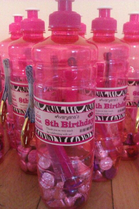 Avaryana's gymnastics 8th birthday party favors~ Water bottles from Dollar Tree $1 each- Zebra peel n stick personalized labels $8.95 for 30 from Ebay- bottles filled with bubbles, lip gloss, stickers and Hersheys kisses (or any small items or candy that will fit thru the opening) and cute plastic olympic style 'winner medals' favors stuck on the side from Wal-mart. ~Cheap + Cute favor idea and the water bottles can be reused later :)