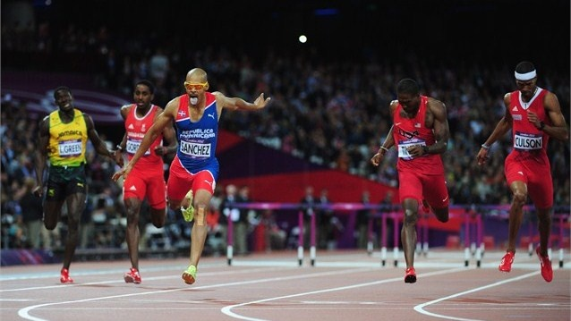 Felix Sanchez of Dominican Republic celebrates after winning gold in the men's 400m Hurdles final.
