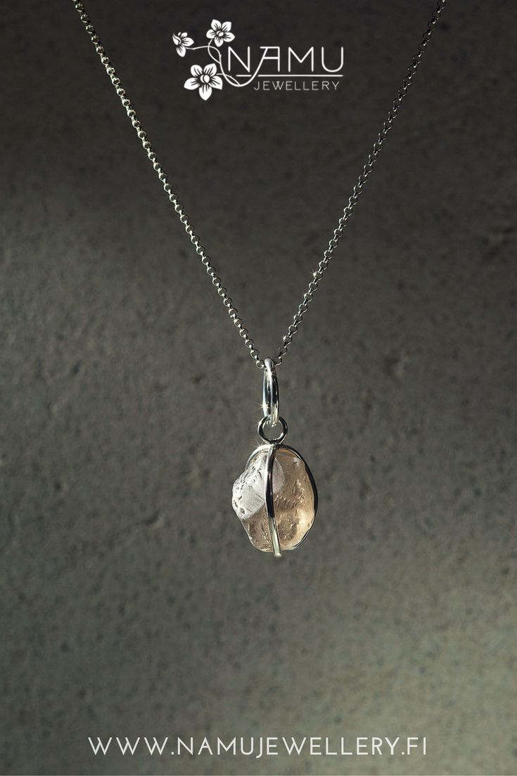 Karu One light smokey quartz pendant. Karu is made of recycled tensed silver wire and ethically sourced hammered stone. It is rough and edgy and it has an attitude.