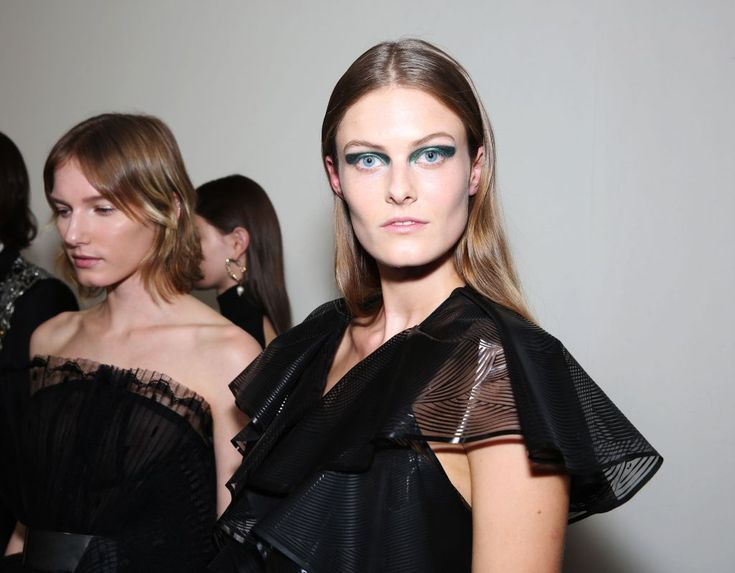 """""""It's about a strong, boyish girl in general,"""" said Guido Palau, working with Redken, referring to the beauty look at Givenchy's couture show. """"So there's a lot of girls with haircuts, short hair. Some are going to have a beautiful chignon. Fashion is about individualism, and I really wanted [this] to feel boyish but [while] still just making the girl the most beautiful she could be."""" Not much product was used on tresses here — only a bit of Redken Wind Blown 05 dry hairspray. — Jennifer…"""