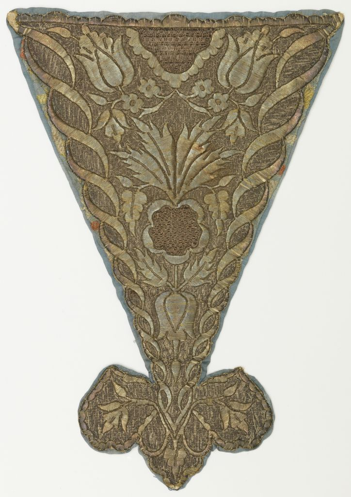 Stomacher, mid-18th century Stomacher with a trefoil point at the bottom, solidly embroidered in silver metallic yarns with a symmetrical design of flowers and leaves, framed by two spiralling ribbons.