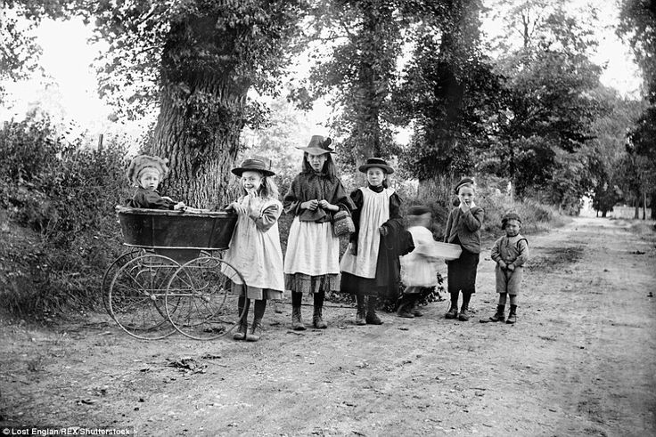 Children in a country lane, Dinton, Buckinghamshire, 1904. The child on the left is in a rather basic perambulator, which was thought to be good for the health