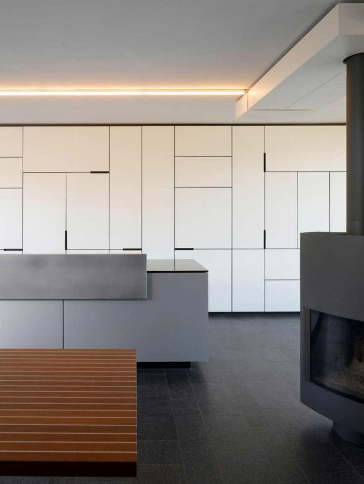 5 Ideas For Unconventional Cabinet Door Designs // These kitchen cabinets play with the sizes of the cabinet doors to create an artistic detail far more interesting than an all white wall of vertical lines.