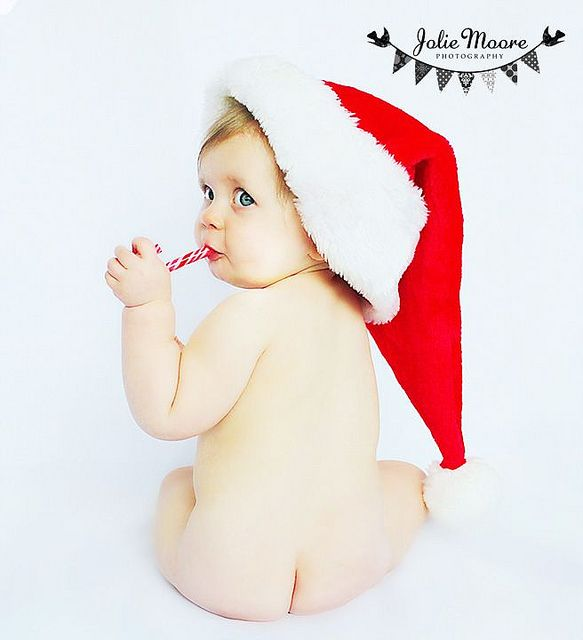 Child with Santa hat and candy cane...too cute.