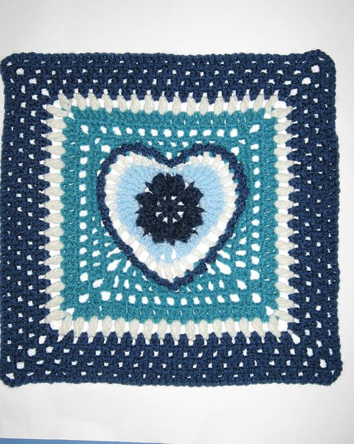 Crochet granny with a heart centre, pattern available on Ravelry.