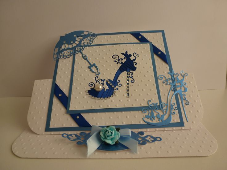 Tattered shoe easel card ribbon folding on the back. The card has been embossed in a crafts too A4 dotty. The umbrella is a marriane die