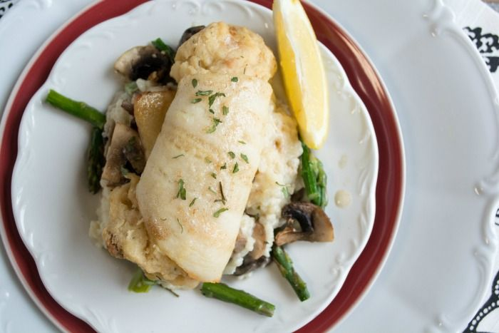 Sole Stuffed with Scallops and Crab with Roasted Asparagus and Mushroom Risotto  Get the full recipe! http://steakbytes.com/recipes/sole-stuffed-scallops-crab-roasted-asparagus-mushroom-risotto/