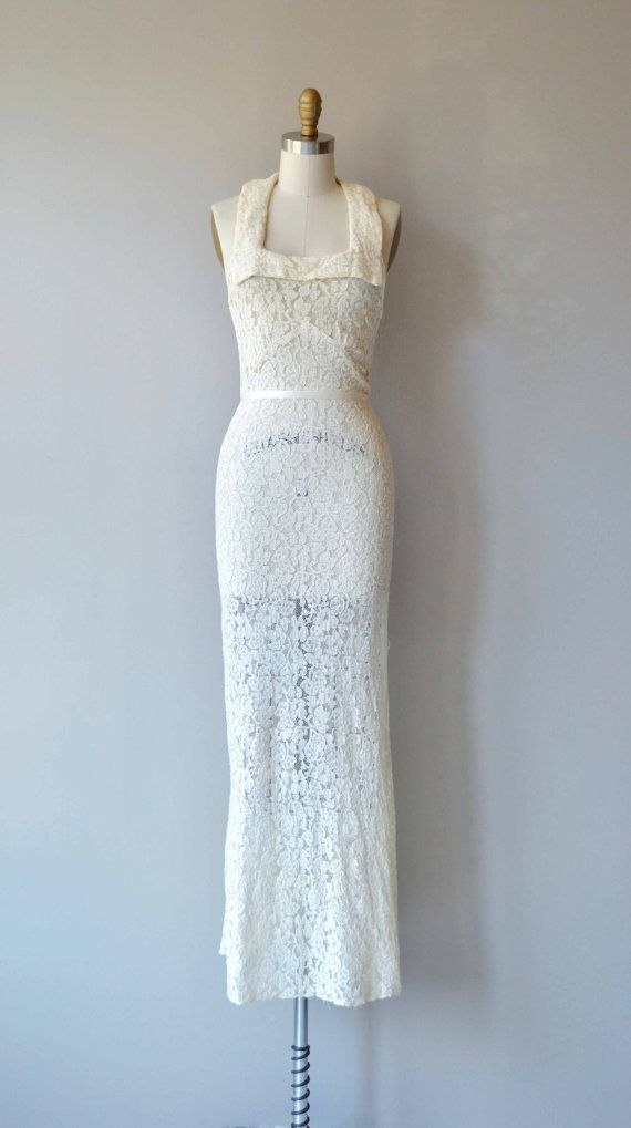 Vintage 1930s white sheer lace wedding gown with unique square neckline, sort of a halter-effect, seamed under bust, bias construction, fantastic open back with diagonal straps and slightly fluted hem. No closures, lace has some stretch and slips on over th head. --- M E A S U R E M E N T S ---  fits like: xs bust: 30 waist: 25 hip: 32 length: 58 brand/maker: n/a condition: very good, one small hole in the lace on both the left and right side of the bust. ✩ layaway is available for ...