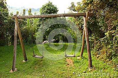 Rustic Wooden Swing Set by Ryan Faas, via Dreamstime