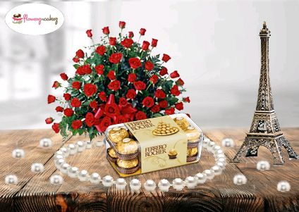 A perfect way to showcase the special appeal of your celebration teamed up with this lovely flower bouquet of 100 red roses and 16 pieces Ferrero Rocher chocolate box.  Order now: http://www.flowerzncakez.com/products/chocolates/with-love.htm