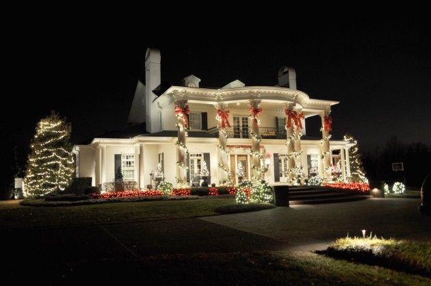A stunning classic columned house decked out with outdoor Christmas lights & decor - Architecture Art Designs
