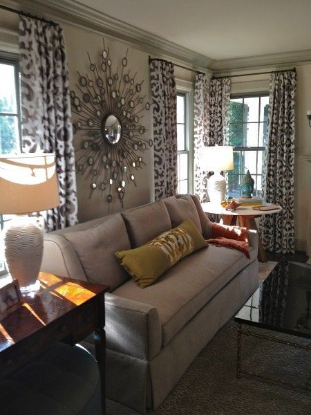 Mirror above couch in middle. Picture gallery on s…