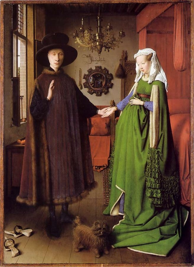 """""""The Arnolfini Portrait"""" from 1434 and is by Jan van Eyck.  Although his painting style is much more similar to Renaissance art, the fashions depicted are still Medieval.  The man wears a fur-lined tappert over a black cotehardie and a wide-brimmed hat.  The woman wears a wimple over her hair as well as a green, fur-lined, high-waisted gown with slashed sleeves over a blue cotehardie."""