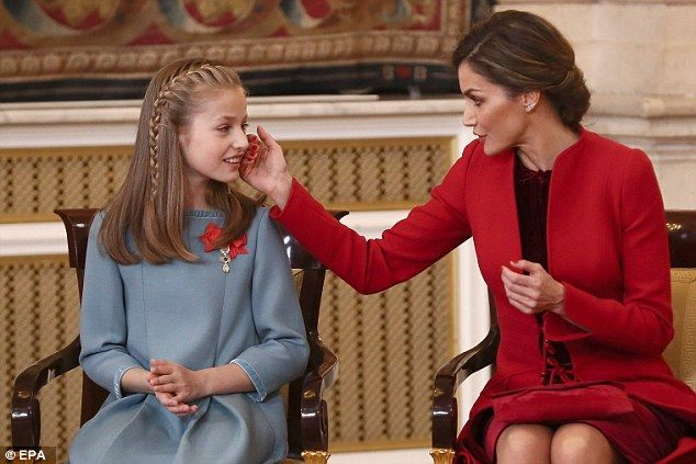Leonor's mother, Queen Letizia, could be seen offering her daughter words of congratulatio...