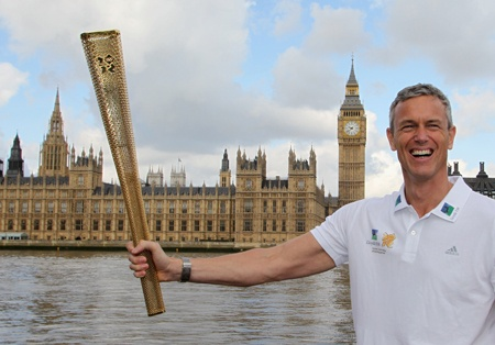 Olympian Mark Foster with the 2012 Olympic Torch