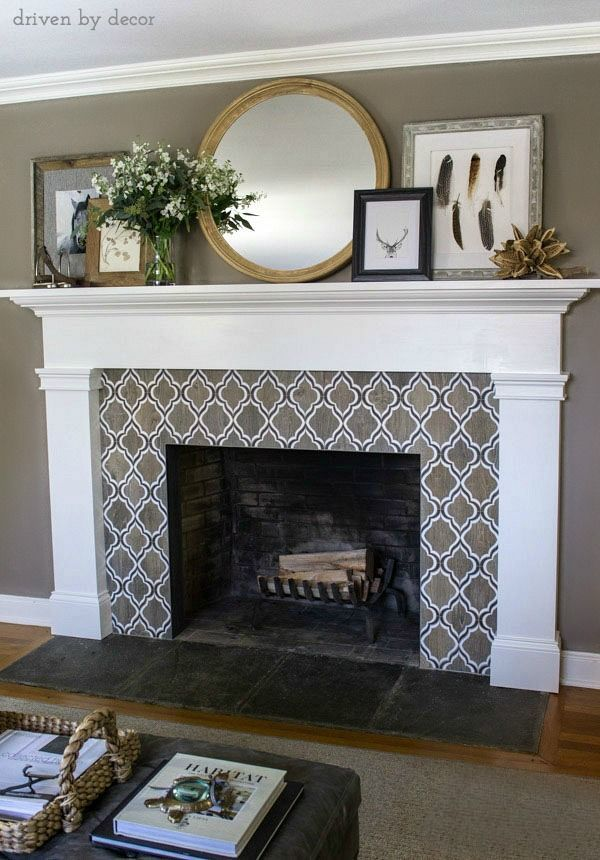Fireplace with fabulous neutral geometric tile | simple mantle design | round mirror | layered art