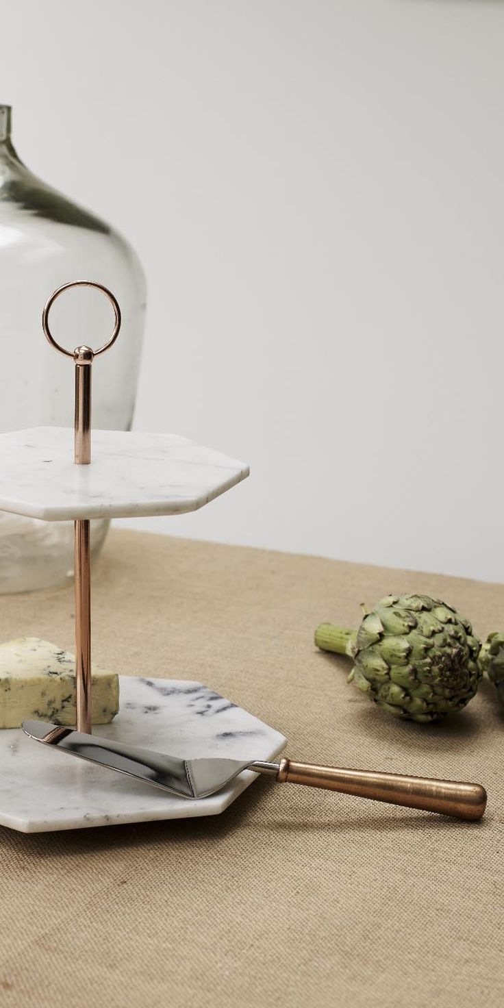Our handcrafted Double Tiered Marble Cake Stand with its angular lines and unusual hexagonal shape makes a sophisticated Christmas gift for her.