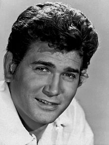 Michael Landon (October 31, 1936 – July 1, 1991) was an American actor, writer, director, and producer. He is known for his roles as Little Joe Cartwright in Bonanza (1959–1973), Charles Ingalls in Little House on the Prairie (1974–1983), and Jonathan Smith in Highway to Heaven (1984–1989). Landon appeared on the cover of TV Guide 22 times, second only to Lucille Ball (TV Guide, July 6, 1991).