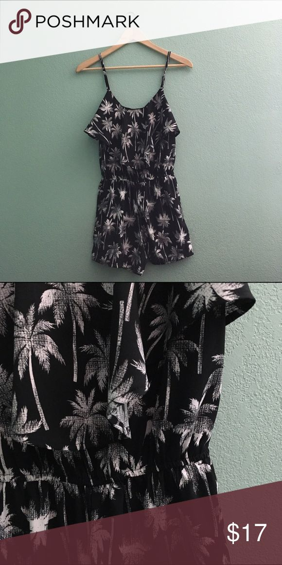 Palm Tree Pattern Ruffle Romper Really cute satin material black romper! With a cinched waist and white palm tree pattern, plus a ruffled top and adjustable straps! worn once, great condition 💕 Dresses Mini