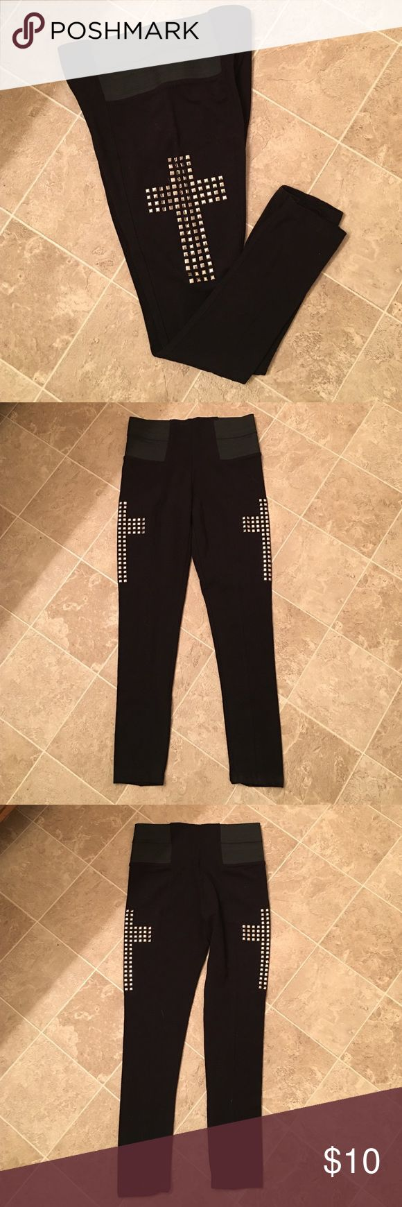 Thick black leggings w/cross studs on both sides Thick leggings (your underwear won't show when you bend over). Has elastic waist band. And cross studs on both thighs Rue 21 Pants Leggings