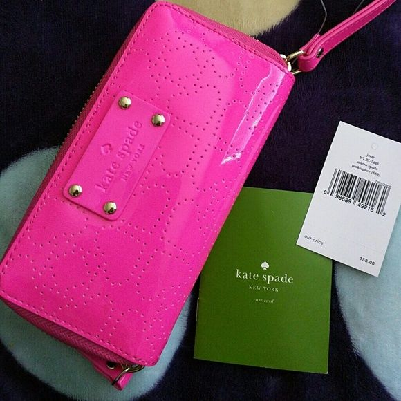 Kate Spade pink wallet/wristlet Rare Kate Spade New York pink wallet/wristlet. This wallet has ? spades embossed all over  and its one of a kind. PLEASE NOTE: THE TAGS ARE NOT ATTACHED. I got it as is but its all brand new with all tissues inside. kate spade Bags Clutches & Wristlets