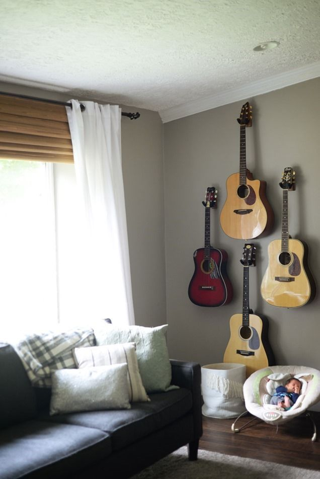 Guitar wall, guitars hung on the wall in living room.