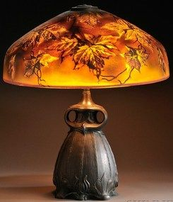 autumn leaves table lamp, art glass and patinated metal, Pittsburgh, Pennsylvania. Domed shade with autumnal leaf decoration, chipped ice surface texture, over a three socket fixture on verdigris owl base. Circa 1905-1915