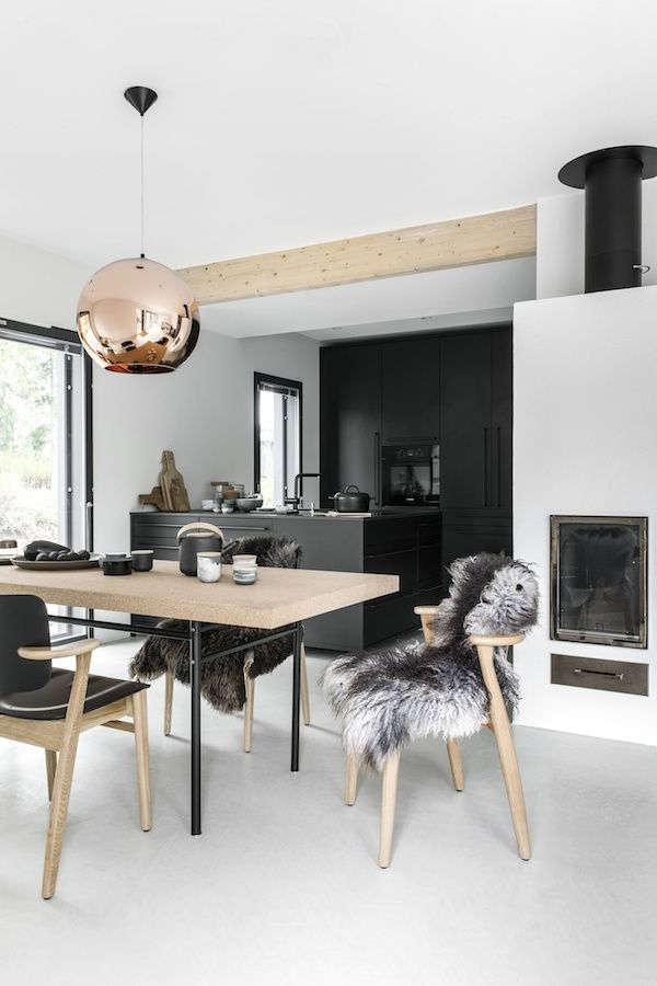 A beautiful all black kitchen and and dining room with lots of cork…