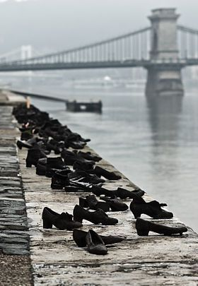 The Shoes on the Danube Promenade is a memorial created by Gyula Pauer and Can Togay on the bank of the Danube River in Budapest. It honors the Jews who were killed by fascist Arrow Cross militiamen in Budapest during World War II. They were ordered to take off their shoes, and were shot at the edge of the water so that their bodies fell into the river and were carried away. It represents their shoes left behind on the bank.