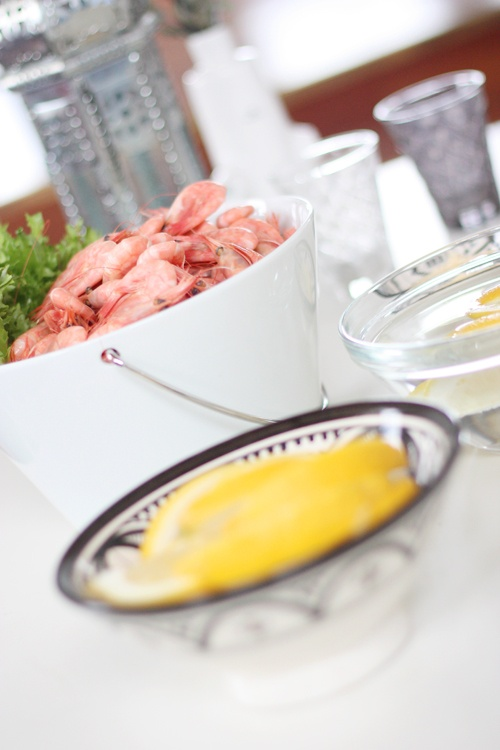 Shrimp feast! Place your lemons in a hand painted black bowl from tinekhome, to add a pop of color on the table.