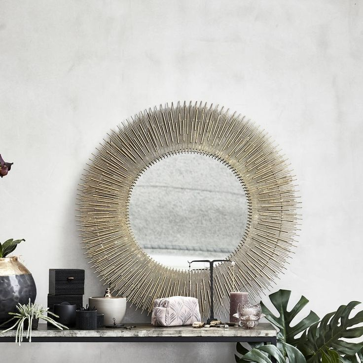 Exquisitely handmade light gold sunburst mirror.Inspired by delicate rays of sunshine this stunning mirror is constructed of light gold-coated iron pins.This can be hung or placed anywhere and will complement both traditional and modern interior schemes.