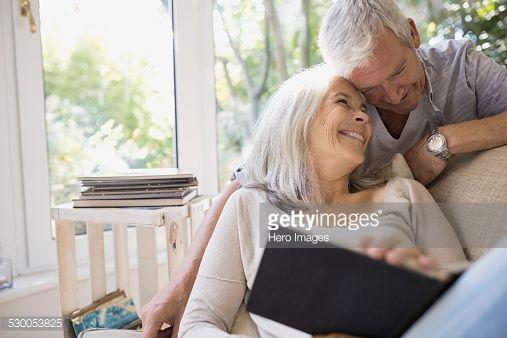 Stock Photo : Senior couple hugging in living room