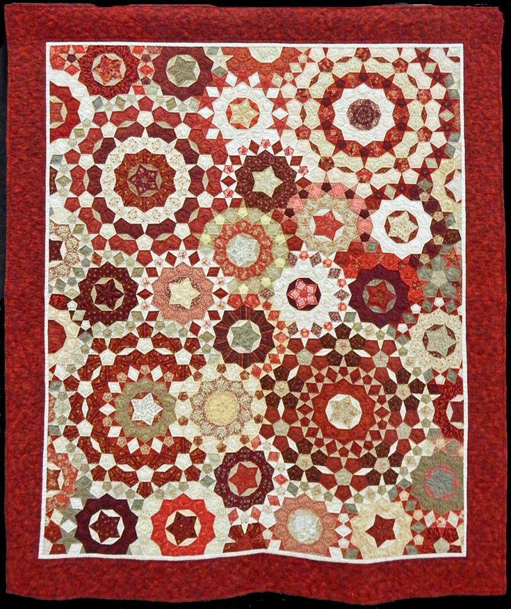 "Red Millefiore (55 by 66"") by Dottie Pope. Based on La Passacaglia by Willyne Hammerstein in her book, ""Millefiore Quilts."""