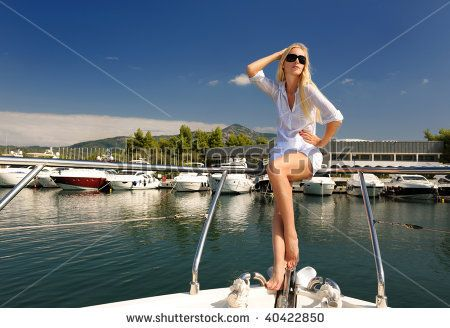The young woman on the yacht - stock photo