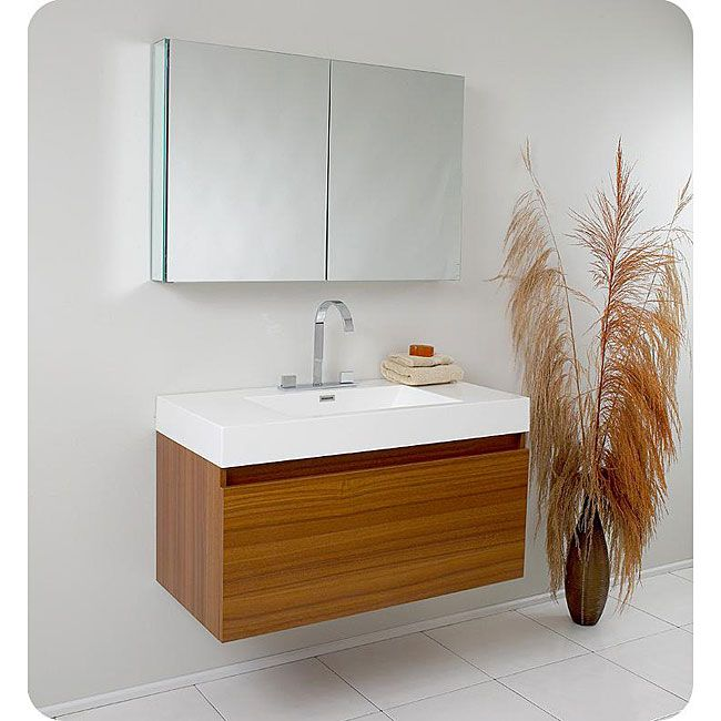 A warm teak finish highlights this Fresca Mezzo modern bathroom vanity. This single-sink vanity features a medicine cabinet and Fresca Sesia faucet.
