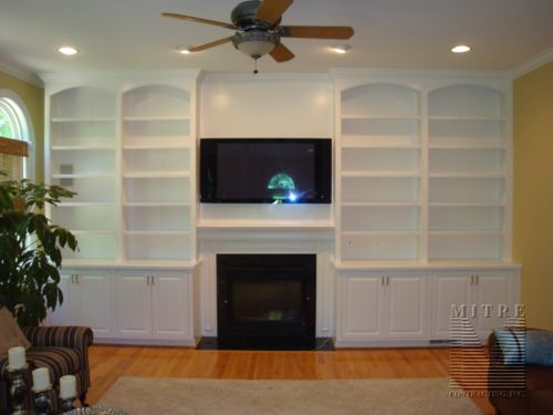 Arch face top, base cabinets, crown moulding, bookcases frame the fat  screen, - Best 20+ Bookshelves Around Fireplace Ideas On Pinterest Shelves