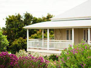 Spring gardens surround this verandah