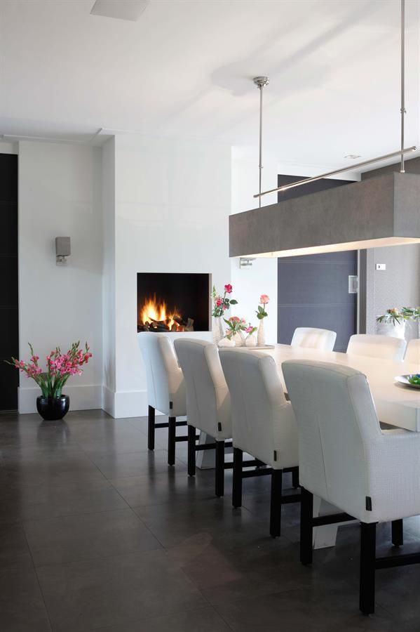 We love a raised #fireplace in the dining room, so everyone can see it.