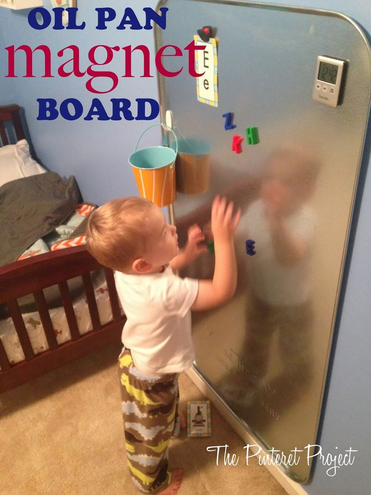 This is an inexpensive way to add another fun dimension to a kids bedroom or playroom - an $11 oil drip pan from Walmart and a bunch of kid friendly magnets and you have yourself a big ol' toddler sized wall o' fun.