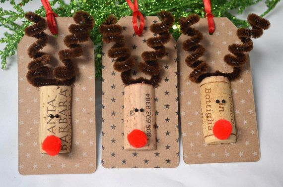 Unique and one-of-a-kind Reindeer Gift Tags handmade in this shop.  Six (6) die-cut tags made Kraft cardstock. There are six Kraft tags - 3 with tiny white stars and 3 with tiny black stars. Each tag is decorated with a repurposed wine cork reindeer head-- that has been hand-cut by me--, spiral chenille antlers and a big red nose. On the reverse, I have hand-stamped To / From in chocolate brown pigment ink for your gift bag or box. Each tag measures 4 1/4 x 2 and has a 10 red ribbon…