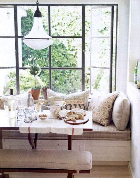 Good Idea For My Nook Under The Window Love Everything About This Breakfast Seat Piled High With Pillows Wood Table Matching