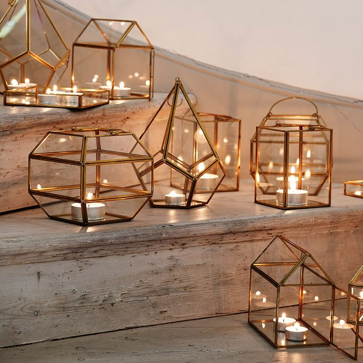 Clustered together and filled with tealights these copper, brass and glass lanterns by Oliver Bonas have interesting faceted shapes