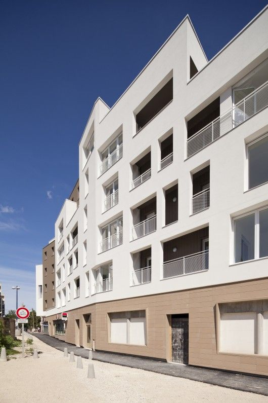 26 Low-energy Public Housing Units and Shops / aEa – agence Engasser + associés