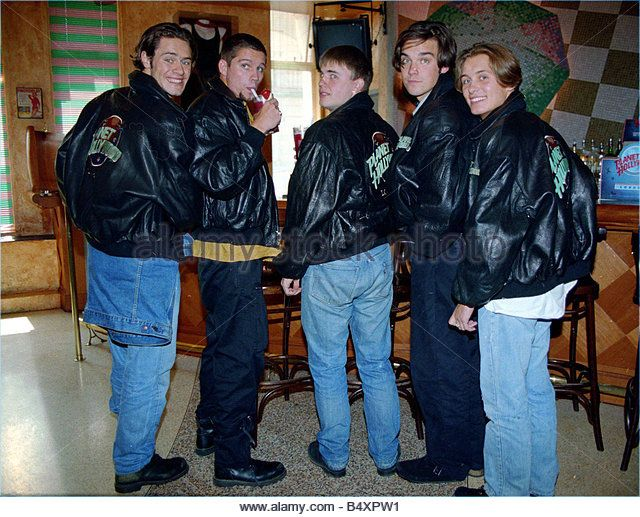 Pop group Take That enjoying a drink in a bar before a signing Left to right are Howard Donald Jason Orange Gary - Stock Image