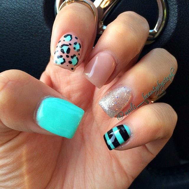 #nails #naildesign #nailart . Aqua and black. Leopard print. Not a fan of the 1 nude nail