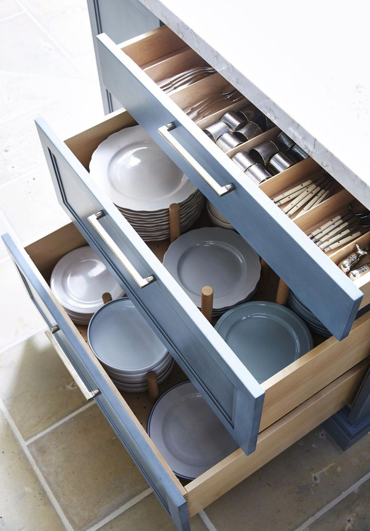 Plate pegs and utensil dividers in painted cabinets. # ...