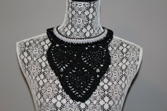 Hand made crochet bib necklace in black, silver and white thread with pineapple stitch design and black sparkly beads. Attached to blackened